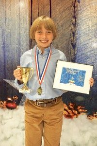 kid with medal and award